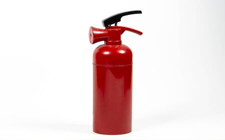 red fire extinguisher on white background.
