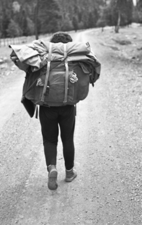 ail: The tourist with a backpack.