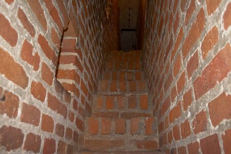 belltower: Bricklaying of walls of a ladder on a belltower. Stock Photo