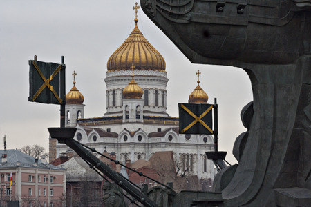 absorbed: The Cathedral of Christ the Saviour is absorbed by a black silhouette of a monument to Pyotr 1 Tsereteli. Moscow. Stock Photo
