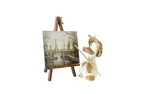 artists model: The toy artist Gus draws a city landscape of Paris.
