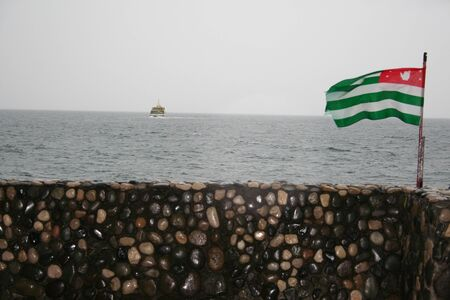 mooring: National flag of Abkhazia on the mooring of Pitsunda. Stock Photo