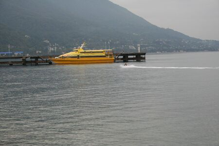 mooring: Yellow catamaran at the mooring in Pitsunda Abkhazia. Stock Photo