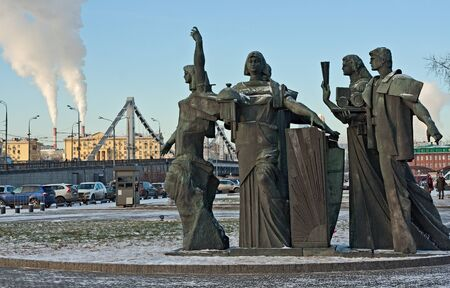realism: The sculptural group devoted to work and creativity costs at an entrance to park Muzeon with meeting of sculptures of socialist realism. Stock Photo