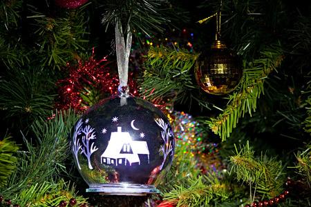 Christmas tree. Christmas decorations with internal illumination hang on a fir-tree.