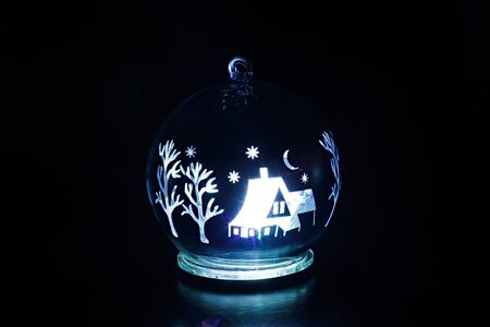The Christmas tree decoration in the form of a sphere has multi-colored internal illumination.