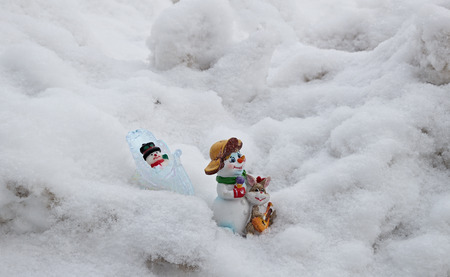 Children's Christmas tree decorations go on deep snow home after Christmas holidays.