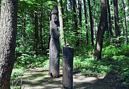 2 5: Figure of Dazhdbog - Slavic god of the sun, fertility and abundance. It makes in height about 2,5 meters and is cut out from an ash-tree trunk ... In hands of Dazhdboga - a solar symbol. Russia. Moscow. Tsaritsyno park.