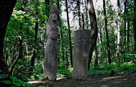 Figure of Dazhdbog - Slavic god of the sun, fertility and abundance. It makes in height about 2,5 meters and is cut out from an ash-tree trunk ... In hands of Dazhdboga - a solar symbol. Russia. Moscow. Tsaritsyno park.