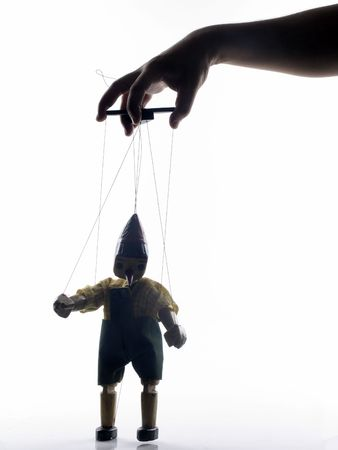puppet theatre: puppet on the string with hand Stock Photo
