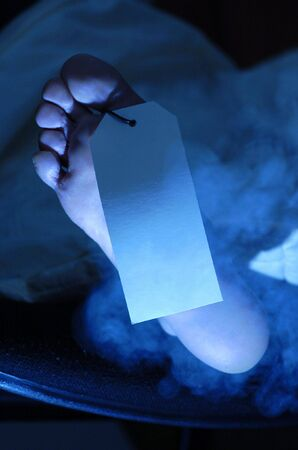 feet of dead man with label in hospital Stock Photo