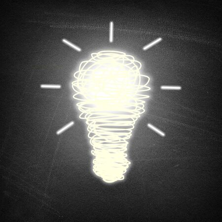 Lightbulb idea on chalkboard background Imagens