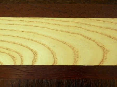 wood panelled: Woodgrain of an elm panel between hardwood panels used in the construction of a panelled wood floor Stock Photo