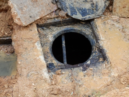 plumbing: Septic tank after being emptied Stock Photo
