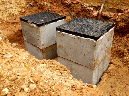New septic tank inspection hatches being installed photo