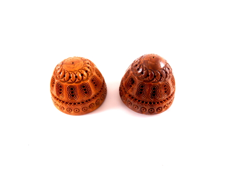 ovoid: Close up of two halves of an antique carved Coquilla Nut from the fruit of a Brazilian Palm. They screw together to form an egg and have various uses such as a sewing egg flea trap or pomander. Stock Photo