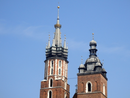The two towers of Saint Marys Basilica in Main Square, Krakow, Poland