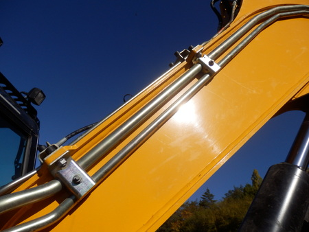 hydraulic hoses: Hydraulic pipes on the arm of an excavator Stock Photo