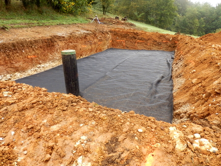 seepage: Membrane laid to separate the sand from the gravel in the construction of a sand and gravel filter bed Stock Photo