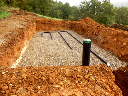 industrial site: Bottom layer of pipework laid on gravel in the construction of a sand and gravel drainage system Stock Photo