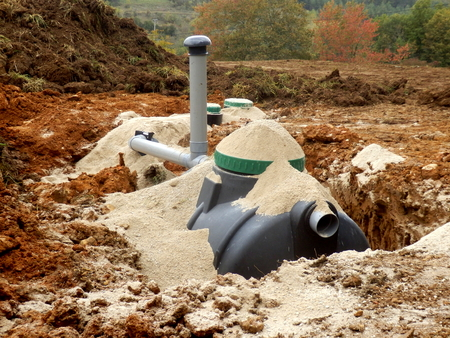 seepage: Filter, automatic flush and ventilation pipe components being installed as part of a sand and gravel filter bed