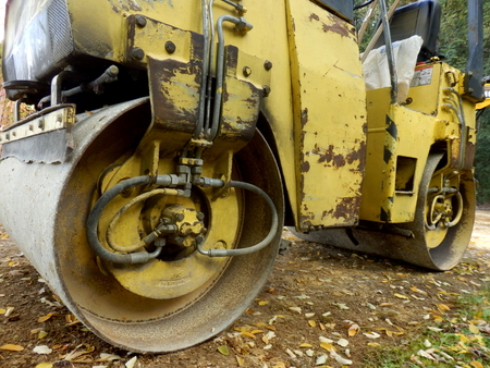 vibroroller: Close up of a road compactor compacting a sand and gravel drive in the countryside