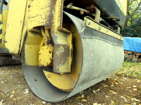 construction vibroroller: Close up of a road compactor compacting a sand and gravel drive in the countryside