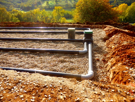 The top layer of pipework, after the membrane, sand and gravel had been applied, during the construction of a sand and gravel drainage system Stockfoto