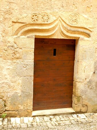 lintel: Medieval door with a carved stone lintel incorporating three Flower of Life symbols, located in the village of Beynac et Cazenac, Dordogne