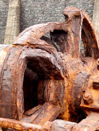 Rusted cog - part of a steam winch located at the old Pier Wilson Coal Wharf at Funchal on the island of Madeira Stock Photo