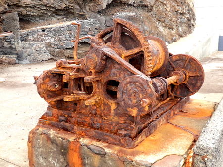 iron oxide: Rusted steam winch located at the old Pier Wilson Coal Wharf at Funchal on the island of Madeira
