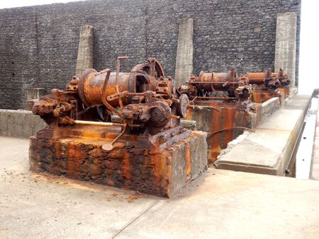 oxidized: Four rusted steam winches located at the old Pier Wilson Coal Wharf at Funchal on the island of Madeira Stock Photo