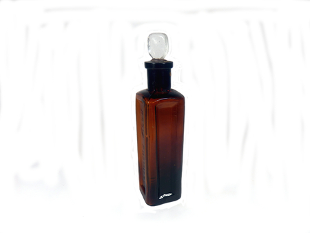 Antique brown pharmaceutical bottle with clear glass stopper, dug up from a disused Victorian tip in Cardiff, Wales