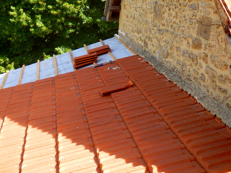 New roof tiles installed following replacement of old terracotta roof tiles
