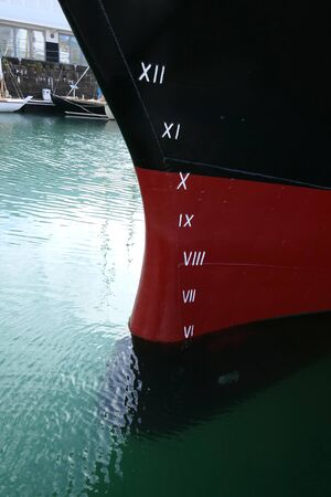 Plimsoll Line painted on a ship hull. An indication of the maximum depth to which the ship may be safely immersed when loaded with cargo.