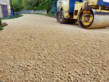 Drive covered with new castings (sand and gravel) prior to being rolled flat