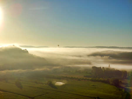 Early morning mist as viewed from a hot air balloon at sunrise Stock Photo