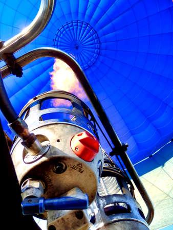 Flame from a propane burner heating the air inside a hot air balloon.