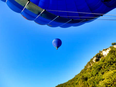 Hot air balloon floating above another balloon Stock Photo
