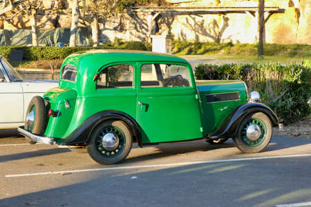 Pristine example of a green Rosengart classic car spotted in a French car park Stock Photo