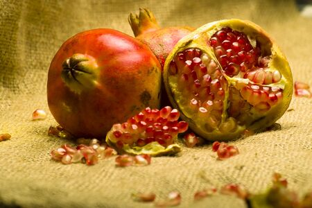 punica granatum: Pomegranete on natural brown sheet
