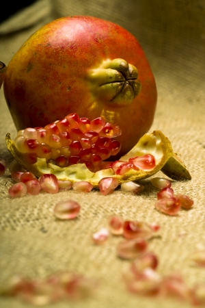 punica granatum: Pomegranate  Punica granatum  fruit o natural sheet Stock Photo