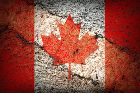 Image of an old canadian flag on the rock texture photo