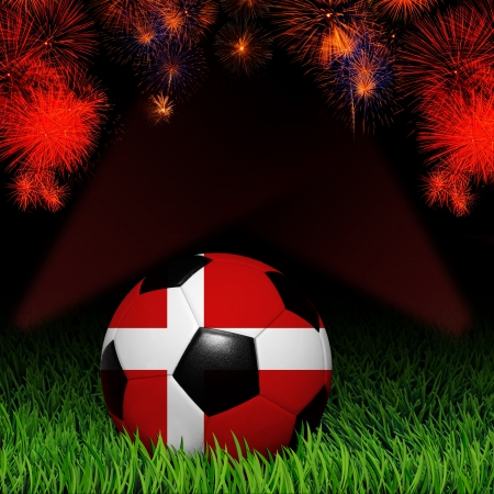 Soccer ball with flag of Denmark, fireworks celebration photo