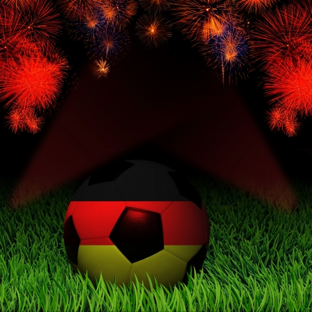 Soccer ball with flag of Germany, fireworks celebration photo
