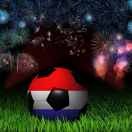 Soccer ball with Netherlands flag pattern on the grass, fireworks celebration  photo