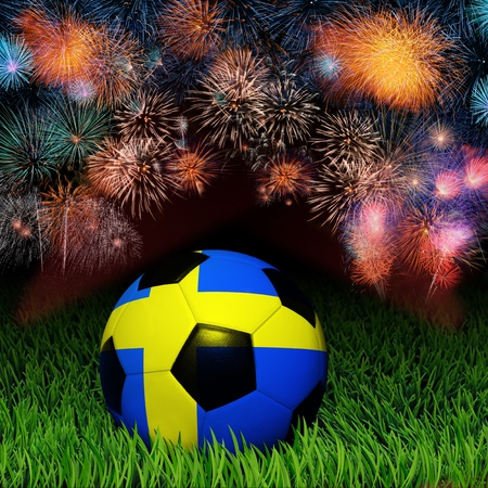 Soccer ball with Sweden flag pattern on the grass, fireworks celebration  photo