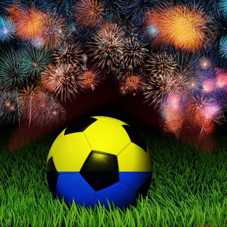 Soccer ball with Ukraine flag pattern on the grass, fireworks celebration  photo