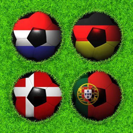 4 Soccer balls with flag pattern on the grass, Group B photo