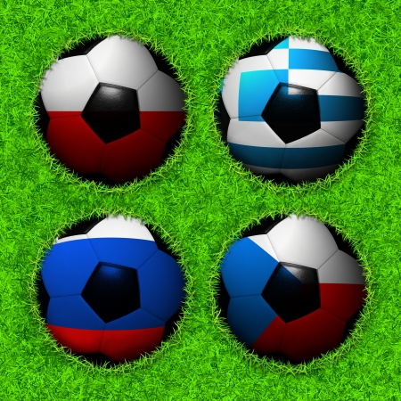 4 Soccer balls with flag pattern on the grass, Group A photo